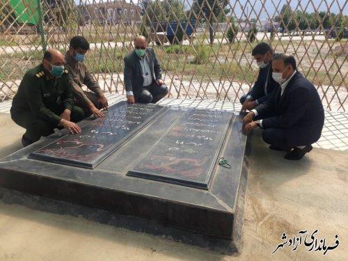غبارروبی و عطرافشانی مزار شهدای گمنام شهرستان آزادشهر